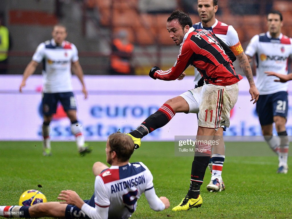 Giampaolo Pazzini (L) of Milan scores the opening goal during the Serie A match between AC Milan and Bologna FC at San Siro Stadium on January 20, 2013 in Milan, Italy.