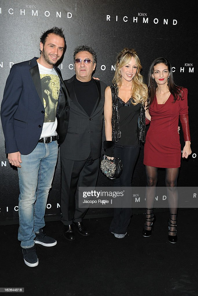 Giampaolo Pazzini, Saverio Moschillo, Silvia Slitti and Alessandra Moschillo attend the John Richmond fashion show as part of Milan Fashion Week Womenswear Fall/Winter 2013/14 on February 25, 2014 in Milan, Italy.