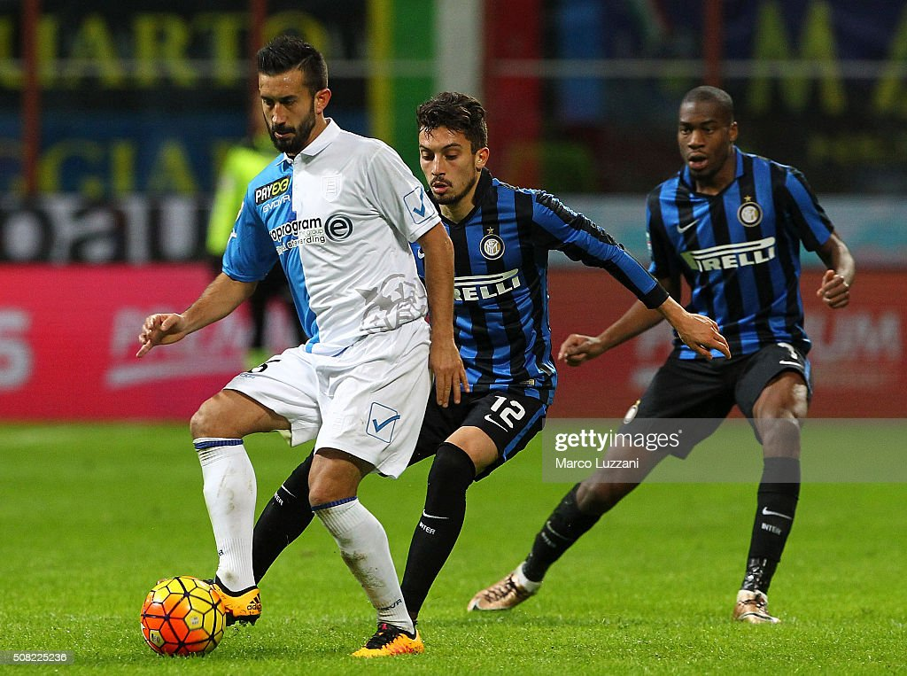 Giampiero Pinzi of AC Chievo Verona is challenged by Alex Telles of FC Internazionale Milano during the Serie A match between FC Internazionale Milano and AC Chievo Verona at Stadio Giuseppe Meazza on February 3, 2016 in Milan, Italy.