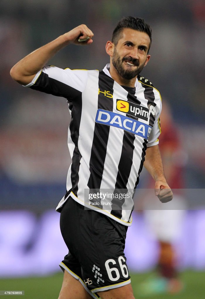 <a gi-track='captionPersonalityLinkClicked' href=/galleries/search?phrase=Giampiero+Pinzi&family=editorial&specificpeople=2164981 ng-click='$event.stopPropagation()'>Giampiero Pinzi</a> of Udinese Calcio celebrates after scoring the first team's goal during the Serie A match between AS Roma and Udinese Calcio at Stadio Olimpico on March 17, 2014 in Rome, Italy.