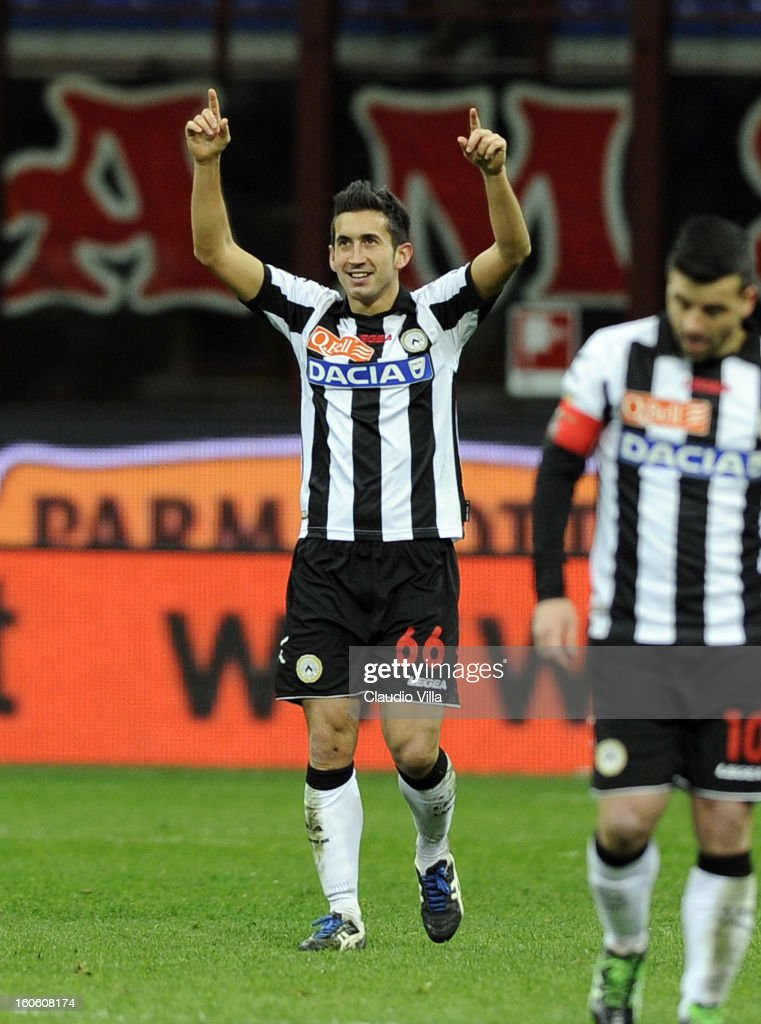 Giampiero Pinzi of Udinese Calcio celebrates scoring the first goal during the Serie A match between AC Milan and Udinese Calcio at San Siro Stadium on February 3, 2013 in Milan, Italy.