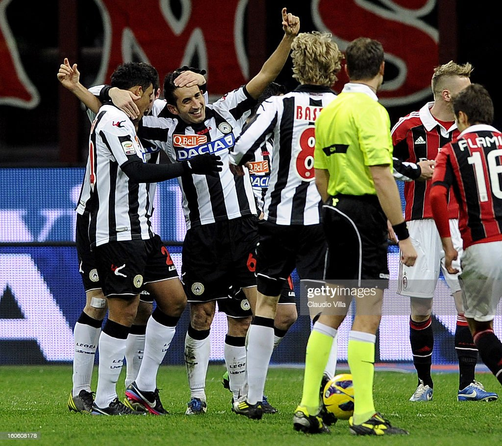 Giampiero Pinzi of Udinese Calcio (C) celebrates scoring the first goal during the Serie A match between AC Milan and Udinese Calcio at San Siro Stadium on February 3, 2013 in Milan, Italy.