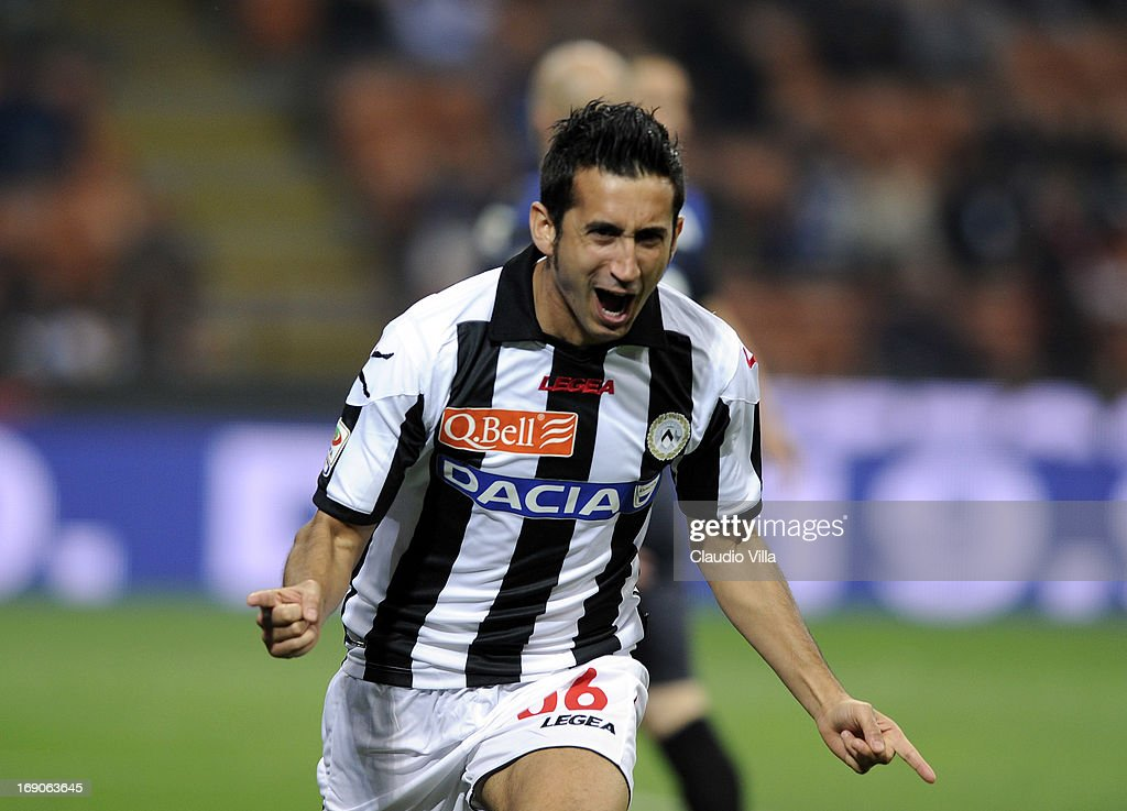 <a gi-track='captionPersonalityLinkClicked' href=/galleries/search?phrase=Giampiero+Pinzi&family=editorial&specificpeople=2164981 ng-click='$event.stopPropagation()'>Giampiero Pinzi</a> of Udinese Calcio celebrates scoring the first goal during the Serie A match between FC Internazionale Milano and Udinese Calcio at San Siro Stadium on May 19, 2013 in Milan, Italy.