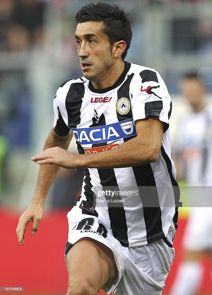 <a gi-track='captionPersonalityLinkClicked' href=/galleries/search?phrase=Giampiero+Pinzi&family=editorial&specificpeople=2164981 ng-click='$event.stopPropagation()'>Giampiero Pinzi</a> of Udinese Calcio in action during the Serie A match between Genoa CFC and Udinese Calcio at Stadio Luigi Ferraris on January 15, 2012 in Genoa, Italy.