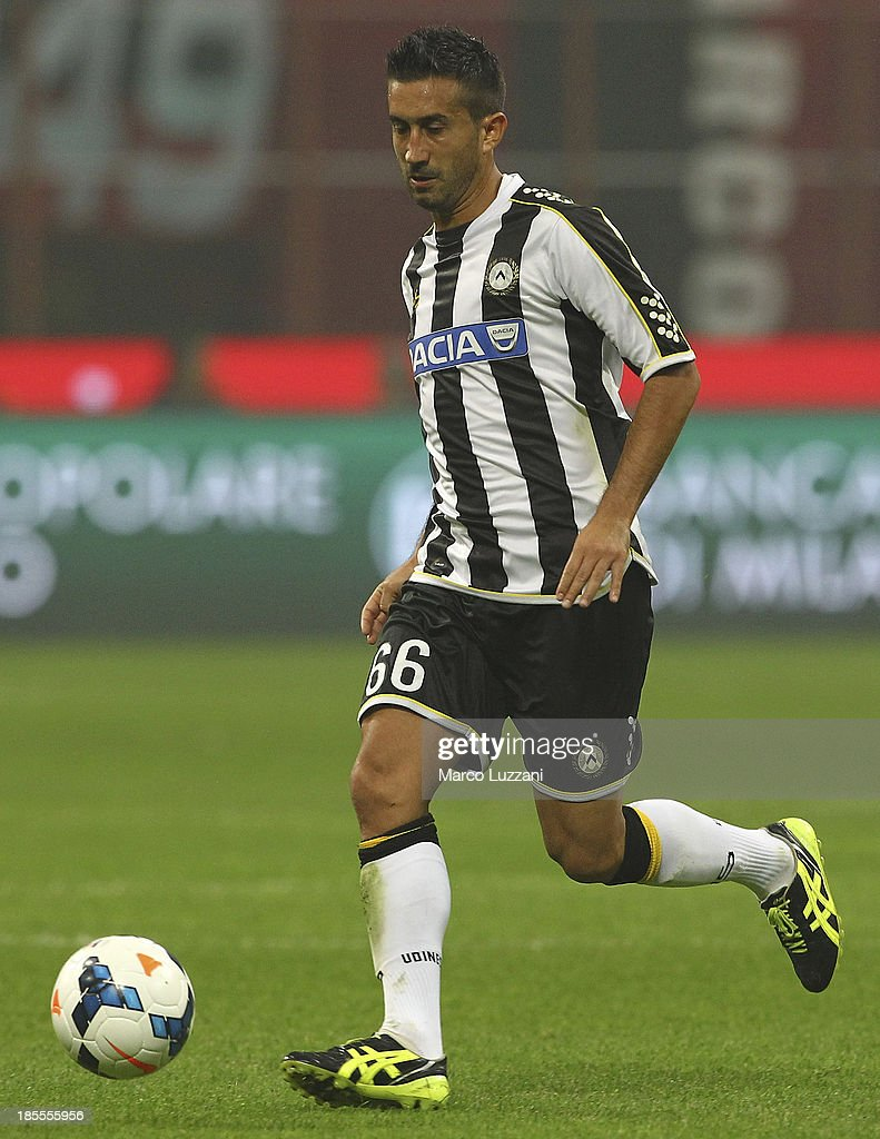 <a gi-track='captionPersonalityLinkClicked' href=/galleries/search?phrase=Giampiero+Pinzi&family=editorial&specificpeople=2164981 ng-click='$event.stopPropagation()'>Giampiero Pinzi</a> of Udinese Calcio in action during the Serie A match between AC Milan and Udinese Calcio at Giuseppe Meazza Stadium on October 19, 2013 in Milan, Italy.