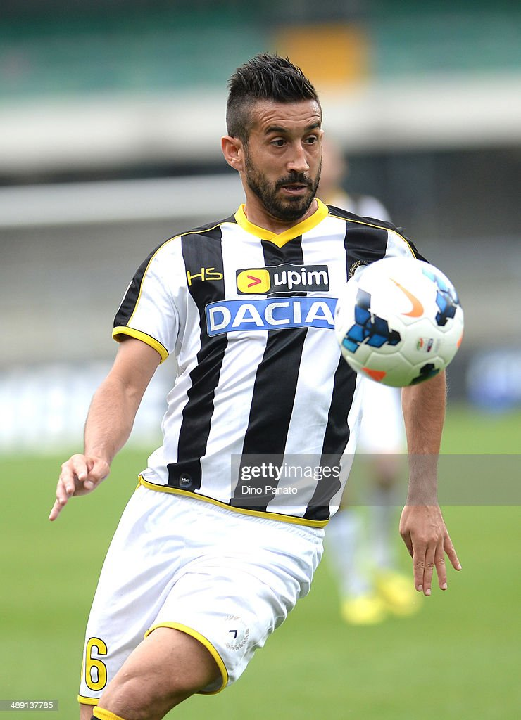 <a gi-track='captionPersonalityLinkClicked' href=/galleries/search?phrase=Giampiero+Pinzi&family=editorial&specificpeople=2164981 ng-click='$event.stopPropagation()'>Giampiero Pinzi</a> of Udinese Calcio in action during the Serie A match between Hellas Verona FC and Udinese Calcio at Stadio Marc'Antonio Bentegodi on May 10, 2014 in Verona, Italy.