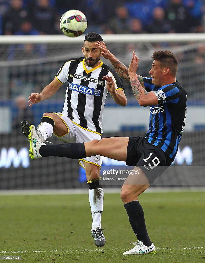 <a gi-track='captionPersonalityLinkClicked' href=/galleries/search?phrase=Giampiero+Pinzi&family=editorial&specificpeople=2164981 ng-click='$event.stopPropagation()'>Giampiero Pinzi</a> of Udinese Calcio is challenged by German Gustavo Denis of Atalanta BC during the Serie A match between Atalanta BC and Udinese Calcio at Stadio Atleti Azzurri d'Italia on March 15, 2015 in Bergamo, Italy.