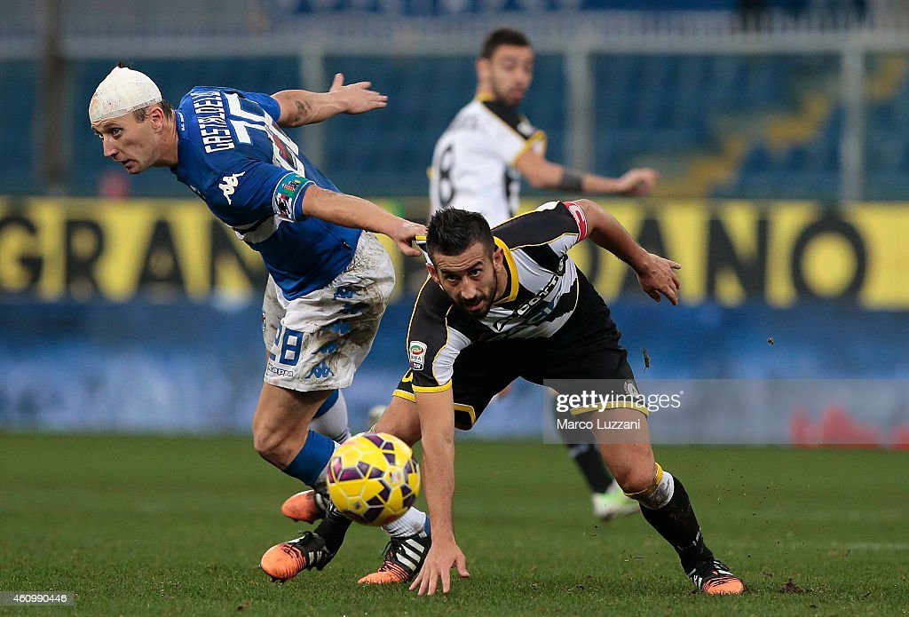 <a gi-track='captionPersonalityLinkClicked' href=/galleries/search?phrase=Giampiero+Pinzi&family=editorial&specificpeople=2164981 ng-click='$event.stopPropagation()'>Giampiero Pinzi</a> (R) of Udinese Calcio is pulled by his shirt by Daniele Gastaldello (L) of UC Sampdoria during the Serie A match betweeen UC Sampdoria and Udinese Calcio at Stadio Luigi Ferraris on December 21, 2014 in Genoa, Italy.
