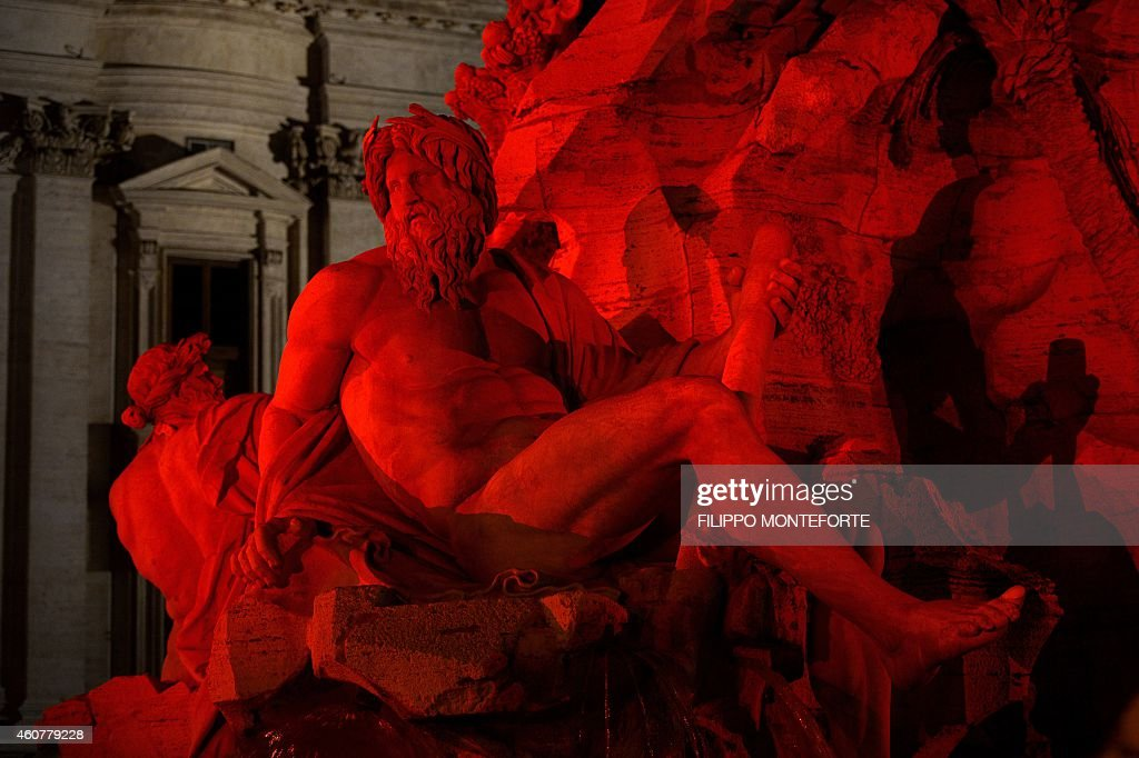 Gian Lorenzo Bernini's Fountain of the Four Rivers is lit in red for the traditional Christmas decorations in Rome's Piazza Navona on December 22, 2014