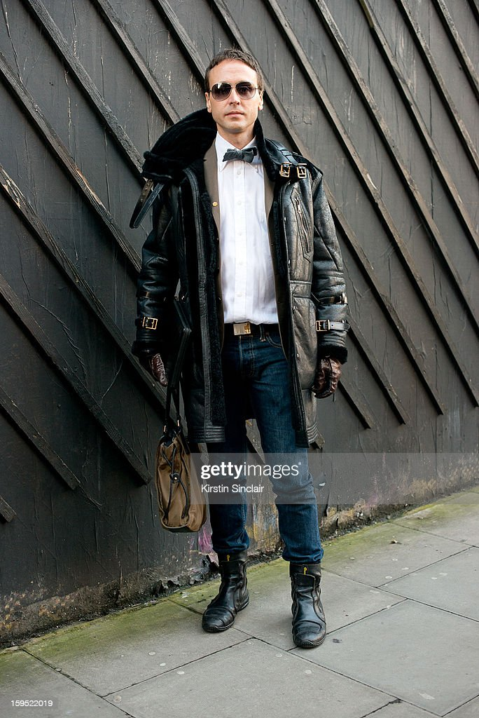 Gian Luca fashon blogger wearing Aldo Brue shoes, Abercrombie and Fitch Jeans, Burberry Jacket, Bow tie and Bag, Sartorial shirt and Tom Ford sunglasses on day 3 of London Mens Fashion Week Autumn/Winter 2013, on January 09, 2013 in London, England.