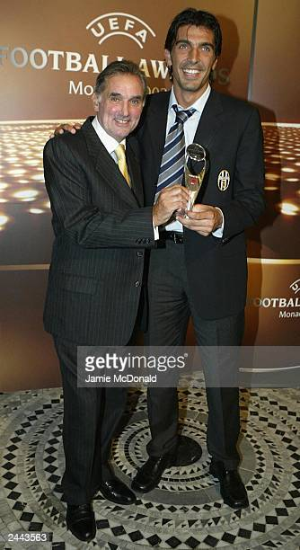 Gian Luigi Buffon with his award and retired football star George Best during the UEFA Football awards at the Golf and Sporting Club on August 28...
