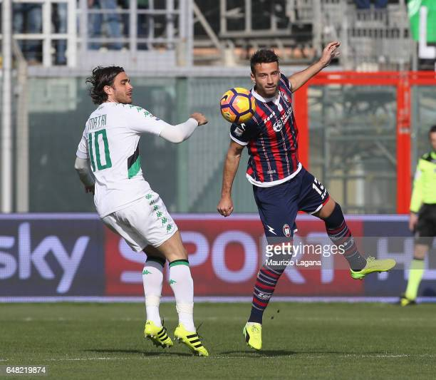 Gian Marco Ferrari of Crotone competes for the ball with Alessandro Matri of Sassuolo during the Serie A match between FC Crotone and US Sassuolo at...