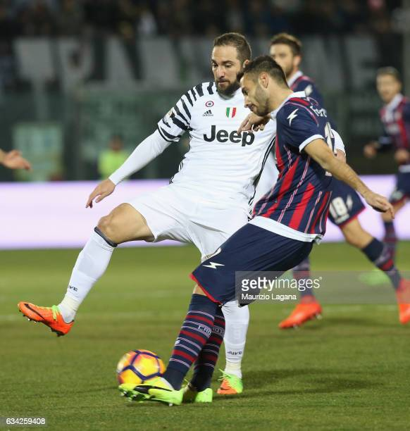 Gian Marco Ferrari of Crotone competes for the ball with Gonzalo Higuain of Juventus during the Serie A match between FC Crotone and Juventus FC at...