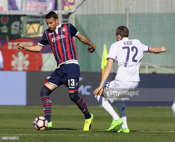 Gian Marco Ferrari of Crotone competes for the ball with Josip Ilicic of Fiorentina during the Serie A match between FC Crotone and ACF Fiorentina at...