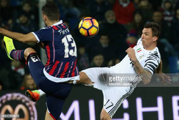 Gian Marco Ferrari of Crotone competes for the ball with Mario Mandzukic of Juventus during the Serie A match between FC Crotone and Juventus FC at...