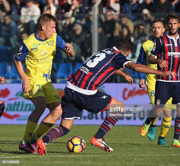 Gian Marco Ferrari of Crotone competes for the ball with Valter Birsa of Chievo during the Serie A match between FC Crotone and AC ChievoVerona at...