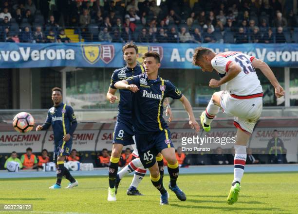 Gian Marco Ferrari of Crotone scores his opening goal during the Serie A match between AC ChievoVerona and FC Crotone at Stadio Marc'Antonio...