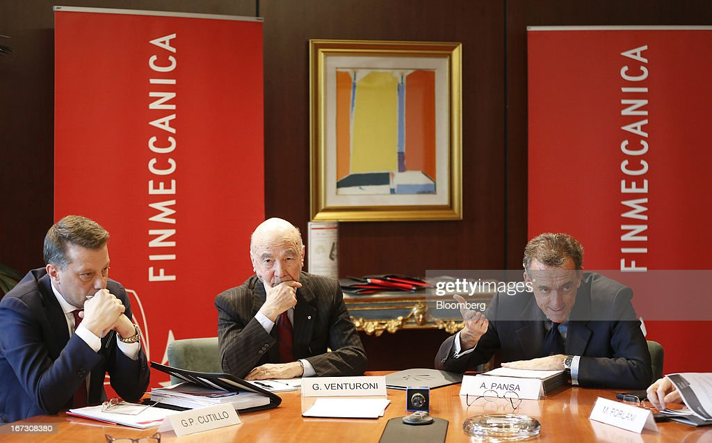 Gian Piero Cutillo chief financial officer of Finmeccanica SpA left Guido Venturoni vice chairman of Finmeccanica SpA center and Alessandro Pansa...