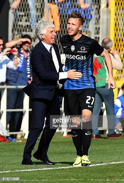 Gian Piero Gasperini Head Coach of Atalanta BC clbrates the second goal with Jasmin Kurtic of Atalanta BC during the Serie A match between Atalanta...