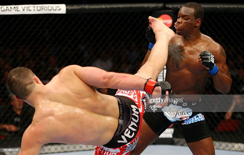 Gian Villante (L) kicks Ovince Saint Preux (R) in their light heavyweight bout during the UFC 159 event at the Prudential Center on April 27, 2013 in Newark, New Jersey.