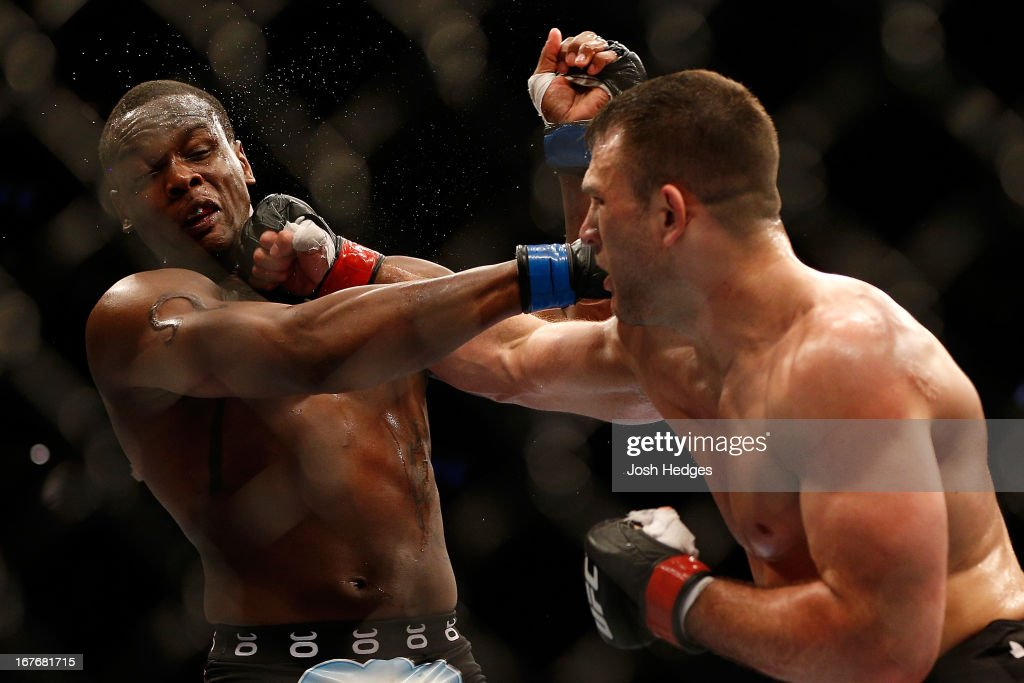 Gian Villante punches Ovince Saint Preux in their light heavyweight fight during the UFC 159 event at the Prudential Center on April 27, 2013 in Newark, New Jersey.