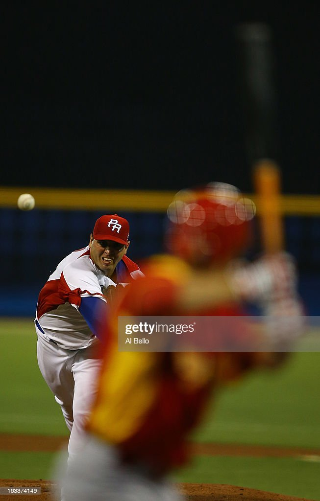Giancarlo Alvarado #31 of Puerto Rico pitches against Paco Figueroa #11 Spain during the first round of the World Baseball Classic at Hiram Bithorn Stadium on March 8, 2013 in San Juan, Puerto Rico.