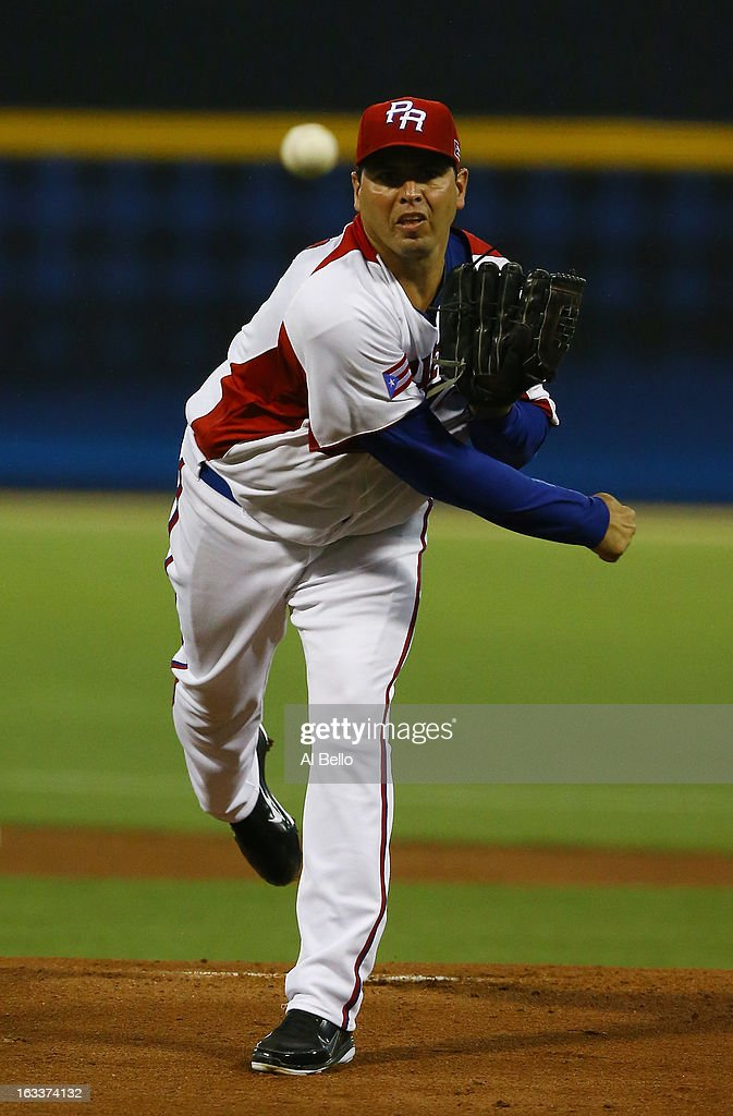 Giancarlo Alvarado #31 of Puerto Rico pitches against Spain during the first round of the World Baseball Classic at Hiram Bithorn Stadium on March 8, 2013 in San Juan, Puerto Rico.