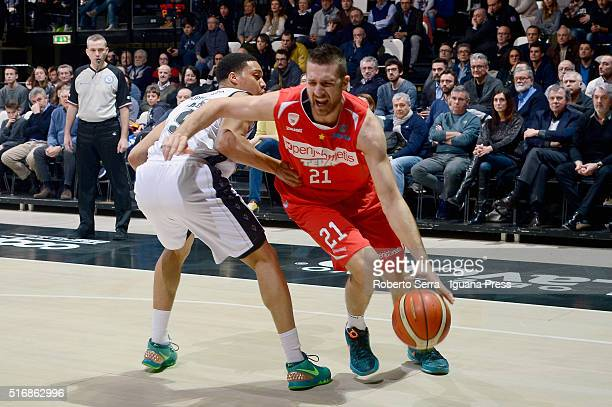 Giancarlo Ferrero of Openjobmetis competes with Abdul Gaddy of Obiettivo Lavoro during the LegaBasket match between Virtus Obiettivo Lavoro vs...