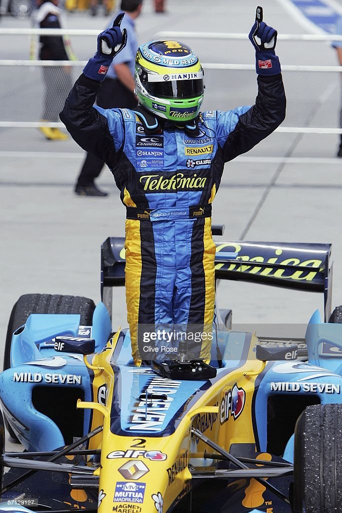 Giancarlo Fisichella of Italy and Renault celebrates in parc ferme afer winning the Malaysian Formula One Grand Prix at the Sepang Circuit on March 19, 2006, in Kuala Lumpur, Malaysia.