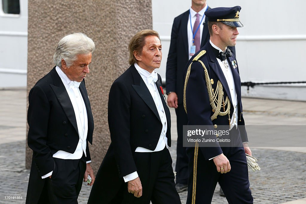 Giancarlo Giametti (L) and Valentino Garavani (C) depart for the travel by boat to Drottningholm Palace for dinner after the wedding of Princess Madeleine of Sweden and Christopher O'Neill hosted by King Carl Gustaf XIV and Queen Silvia at The Royal Palace on June 8, 2013 in Stockholm, Sweden.