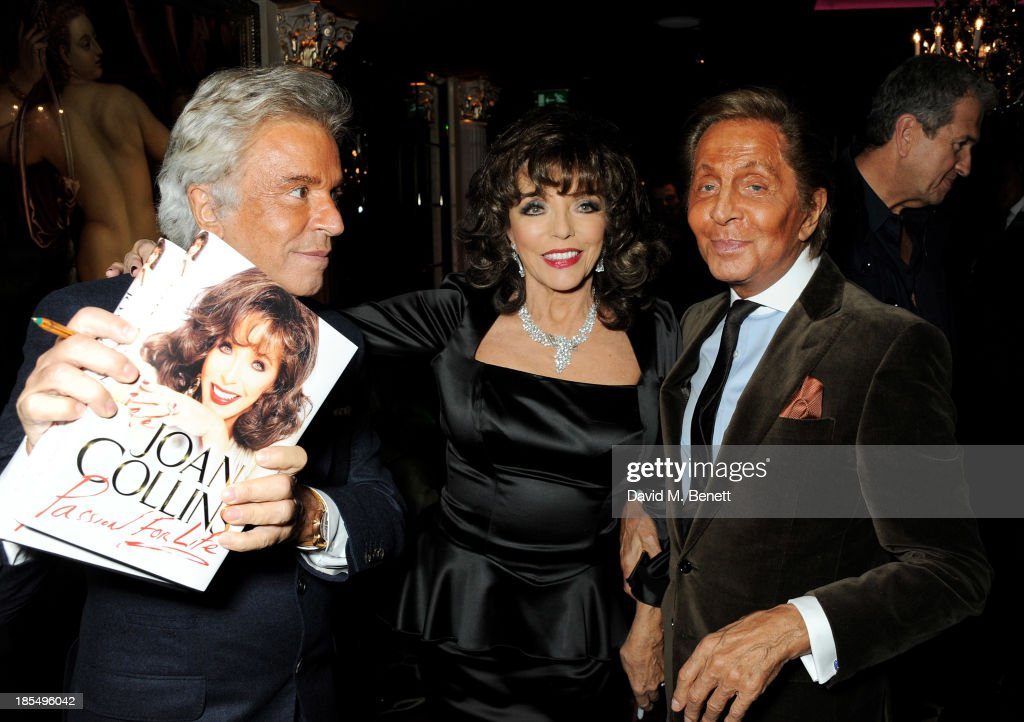 Giancarlo Giammetti, <a gi-track='captionPersonalityLinkClicked' href=/galleries/search?phrase=Joan+Collins&family=editorial&specificpeople=109065 ng-click='$event.stopPropagation()'>Joan Collins</a> and <a gi-track='captionPersonalityLinkClicked' href=/galleries/search?phrase=Valentino+Garavani+-+Fashion+Designer&family=editorial&specificpeople=4297414 ng-click='$event.stopPropagation()'>Valentino Garavani</a> attend the launch of <a gi-track='captionPersonalityLinkClicked' href=/galleries/search?phrase=Joan+Collins&family=editorial&specificpeople=109065 ng-click='$event.stopPropagation()'>Joan Collins</a> new book 'Passion For Life' at No.41 Mayfair Club at The Westbury Hotel on October 21, 2013 in London, England.
