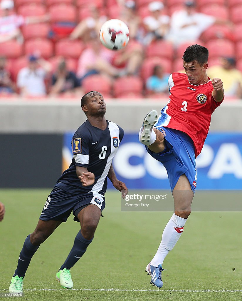 Giancarlo Gonzalez #3 of Costa Rica and Evan Mariano #6 of Belize battle for the ball during the second half of a CONCACAF Gold Cup match July 13, 2013 at Rio Tinto Stadium in Sandy, Utah. Costa Rica defeated Belize 1-0.