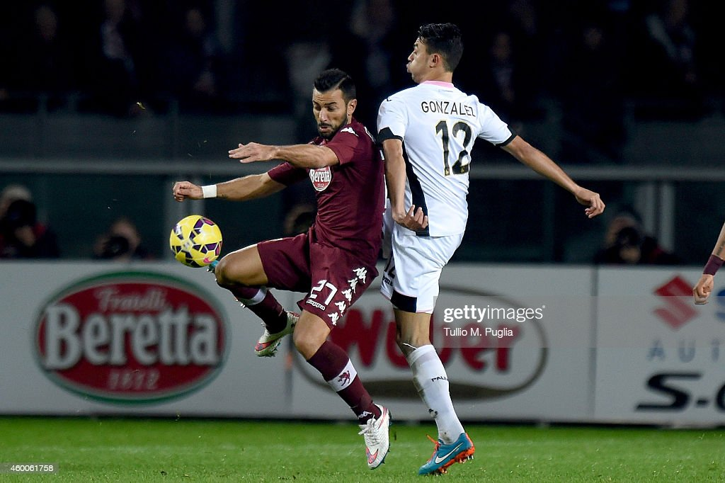 Giancarlo Gonzalez (L) of Palermo and Fabio Quagliarella of Torino compete for the ball during the Serie A match between Torino FC and US Citta di Palermo at Stadio Olimpico di Torino on December 6, 2014 in Turin, Italy.