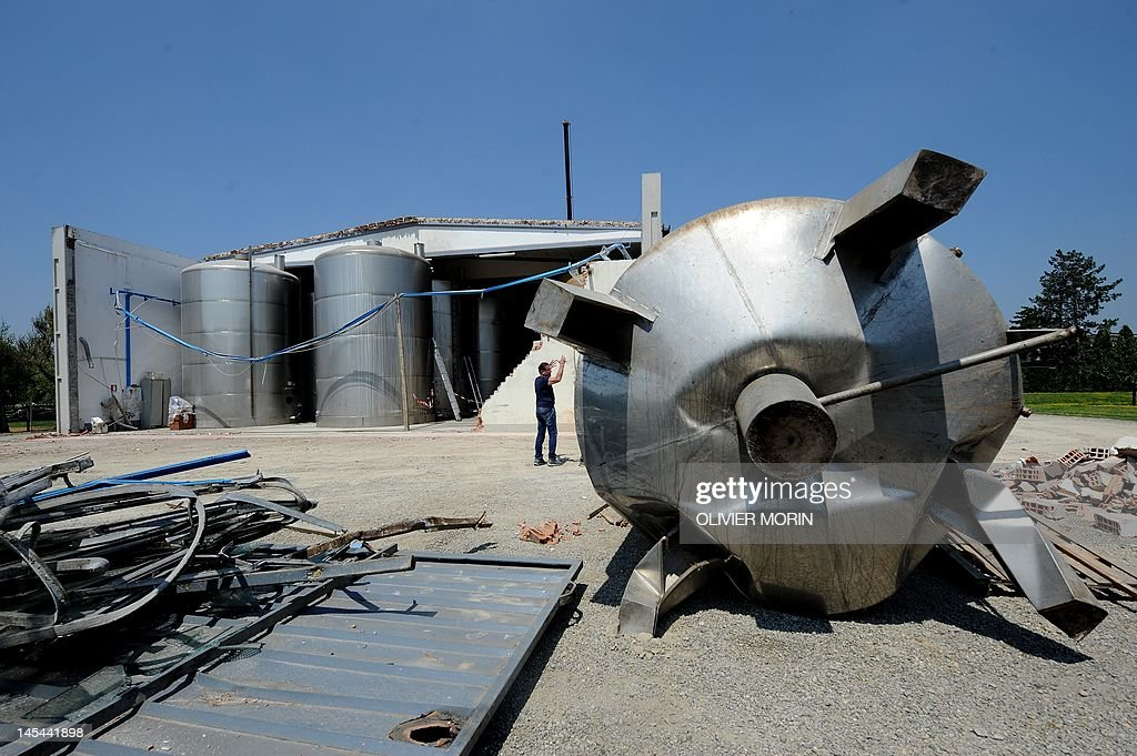Giancarlo Pontiroli, a producer of Modena's balsamic vinegar, shows a tank which had been damaged during the earthquake, on May 30, 2012 in Mirandola.The strong quake which struck Italy on Tuesday, killing 15 and destroying buildings, has also dealt a blow to Modena's balsamic vinegar industry -- days after a quake in the area hit Parmesan production.