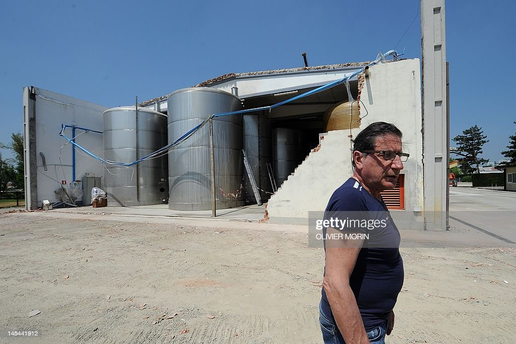 Giancarlo Pontiroli, a producer of Modena's balsamic vinegar, stands by tanks on May 30, 2012 in Mirandola.The strong quake which struck Italy on Tuesday, killing 15 and destroying buildings, has also dealt a blow to Modena's balsamic vinegar industry -- days after a quake in the area hit Parmesan production. AFP PHOTO / OLIVIER MORIN