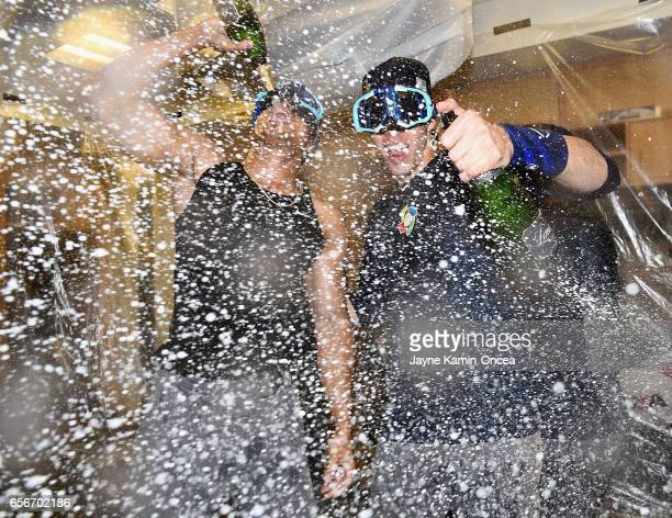 Giancarlo Stanton and Christian Yelich of team United States celebrate in the locker room after their 80 win over Puerto Rico during Game 3 of the...
