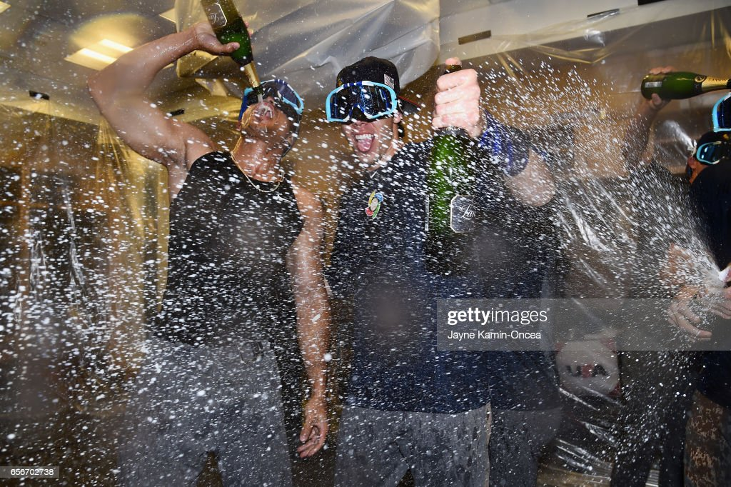 Giancarlo Stanton #27 and Christian Yelich #7 of team United States celebrate in the locker room after their 8-0 win over Puerto Rico during Game 3 of the Championship Round of the 2017 World Baseball Classic at Dodger Stadium on March 22, 2017 in Los Angeles, California.