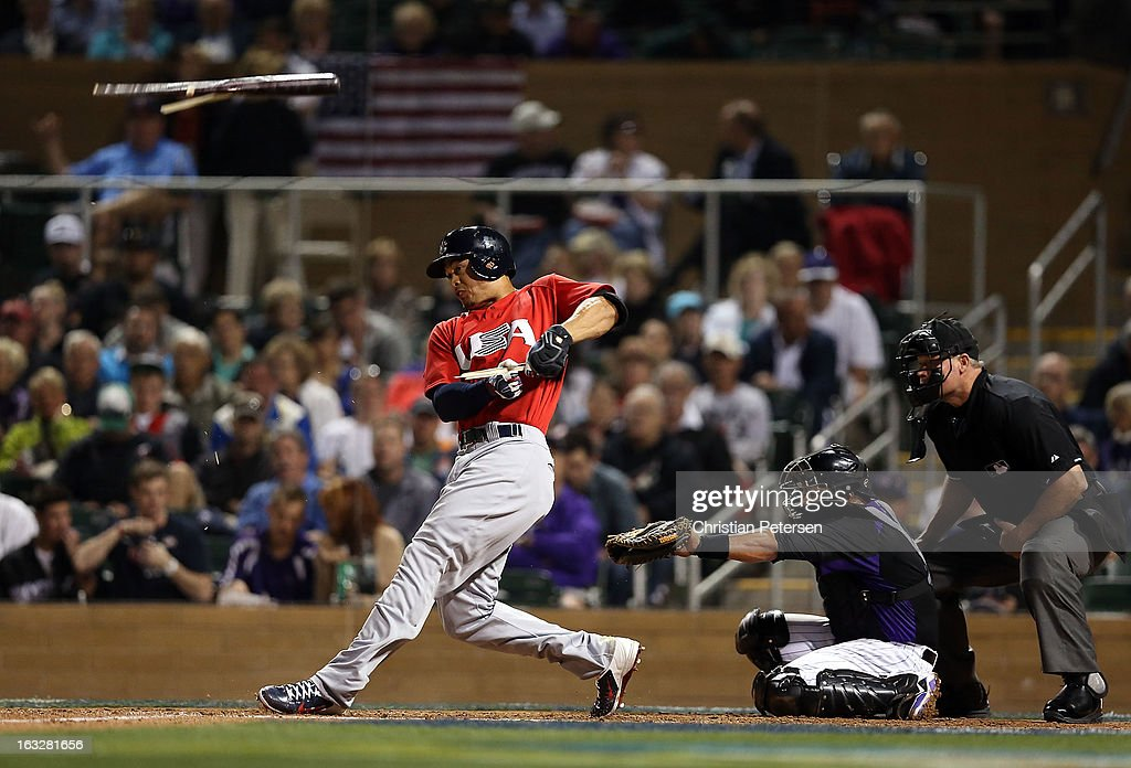 <a gi-track='captionPersonalityLinkClicked' href=/galleries/search?phrase=Giancarlo+Stanton&family=editorial&specificpeople=8983978 ng-click='$event.stopPropagation()'>Giancarlo Stanton</a> #27 of Team USA hits a broken bat single against the Colorado Rockies during the spring training game at Salt River Fields at Talking Stick on March 6, 2013 in Scottsdale, Arizona.