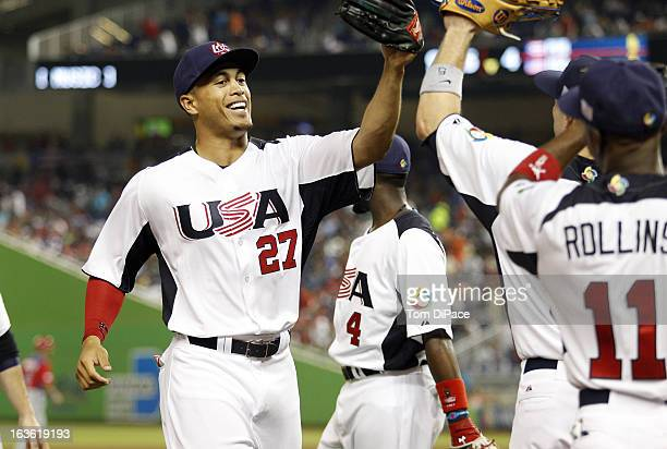 Giancarlo Stanton of Team USA is congratulated after making a great catch during Pool 2 Game 2 against Team Puerto Rico in the second round of the...