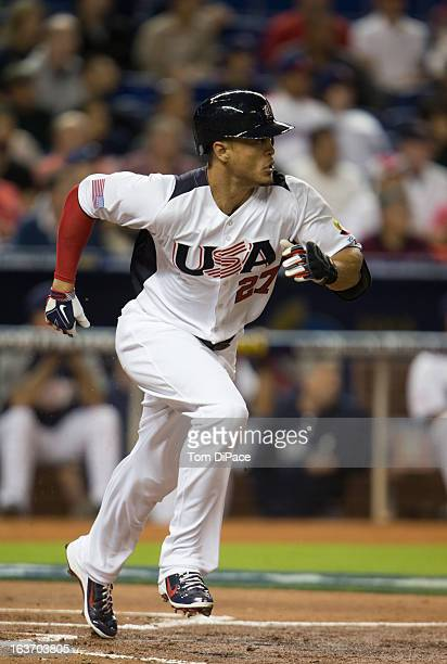 Giancarlo Stanton of Team USA singles in the top of the first inning of Pool 2 Game 4 against Team Dominican Republic in the second round of the 2013...