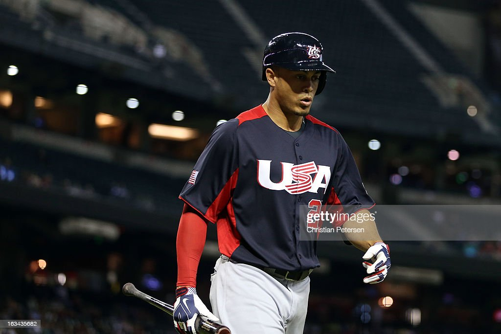 Giancarlo Stanton #27 of Team USA walks back to the dugout after striking out in the fourth inning against Team Italy during the World Baseball Classic First Round Group D game at Chase Field on March 9, 2013 in Phoenix, Arizona.