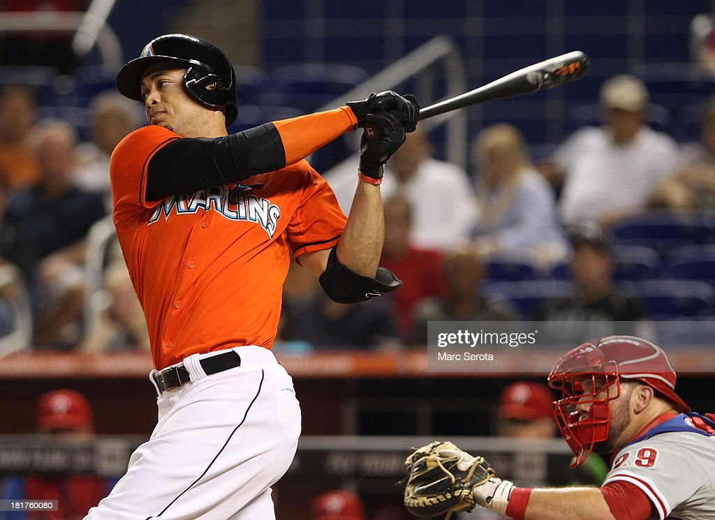<a gi-track='captionPersonalityLinkClicked' href=/galleries/search?phrase=Giancarlo+Stanton&family=editorial&specificpeople=8983978 ng-click='$event.stopPropagation()'>Giancarlo Stanton</a> #27 of the Miami Marlins at Marlins Park singles against the Philadelphia Phillies on September 24, 2013 in Miami, Florida. The Phillies defeated the Marlins 2-1 to give Miami 100 losses for the season.