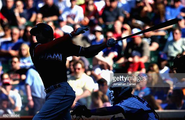 Giancarlo Stanton of the Miami Marlins bats in the 8th inning against the Chicago Cubs at Wrigley Field on June 6 2014 in Chicago Illinois