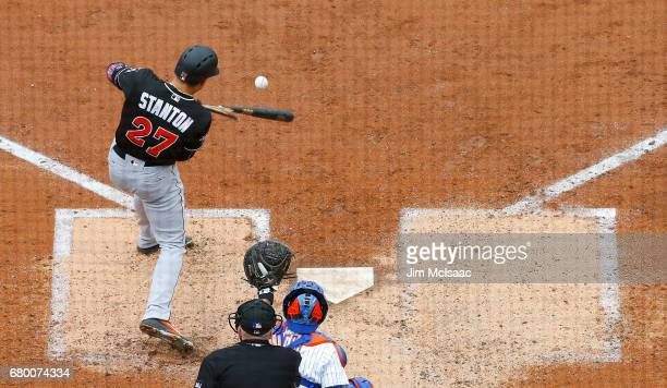 Giancarlo Stanton of the Miami Marlins breaks his bat as he pops out in the fifth inning against the Miami Marlins at Citi Field on May 7 2017 in the...