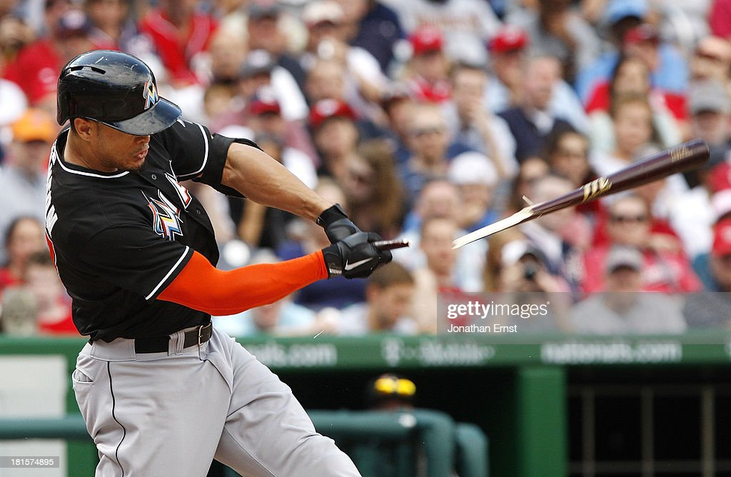 <a gi-track='captionPersonalityLinkClicked' href=/galleries/search?phrase=Giancarlo+Stanton&family=editorial&specificpeople=8983978 ng-click='$event.stopPropagation()'>Giancarlo Stanton</a> #27 of the Miami Marlins breaks his bat on a swing against the Washington Nationals during the eighth inning of game 1 of their day-night doubleheader at Nationals Park on September 22, 2013 in Washington, DC.