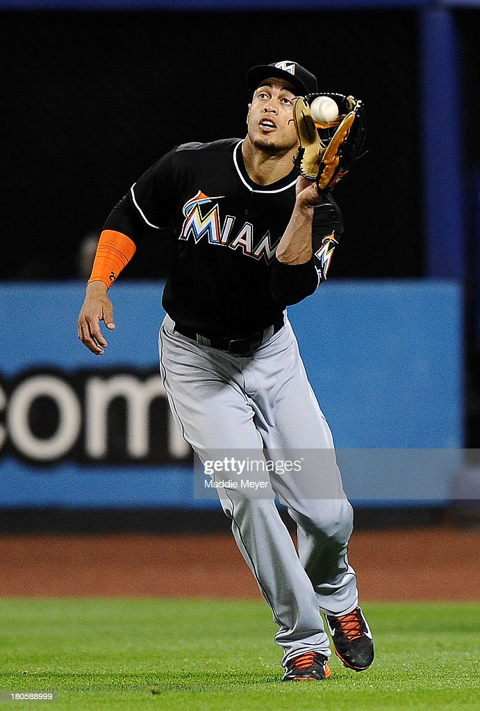 <a gi-track='captionPersonalityLinkClicked' href=/galleries/search?phrase=Giancarlo+Stanton&family=editorial&specificpeople=8983978 ng-click='$event.stopPropagation()'>Giancarlo Stanton</a> #27 of the Miami Marlins catches a fly ball hit by Juan Lagares #12 of the New York Mets during the seventh inning of game two of a double header on September 14, 2013 at Citi Field in the Flushing neighborhood of the Queens borough of New York City.