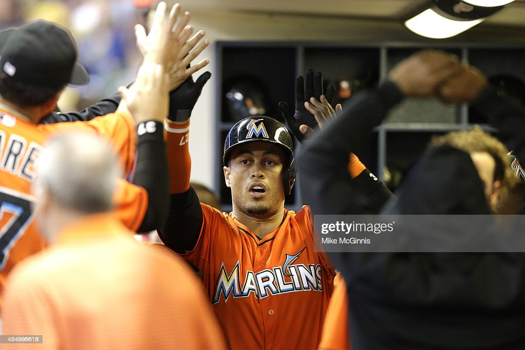 Giancarlo Stanton of the Miami Marlins celebrates after hitting a solo home run in the top of the third inning against the Milwaukee Brewers at...