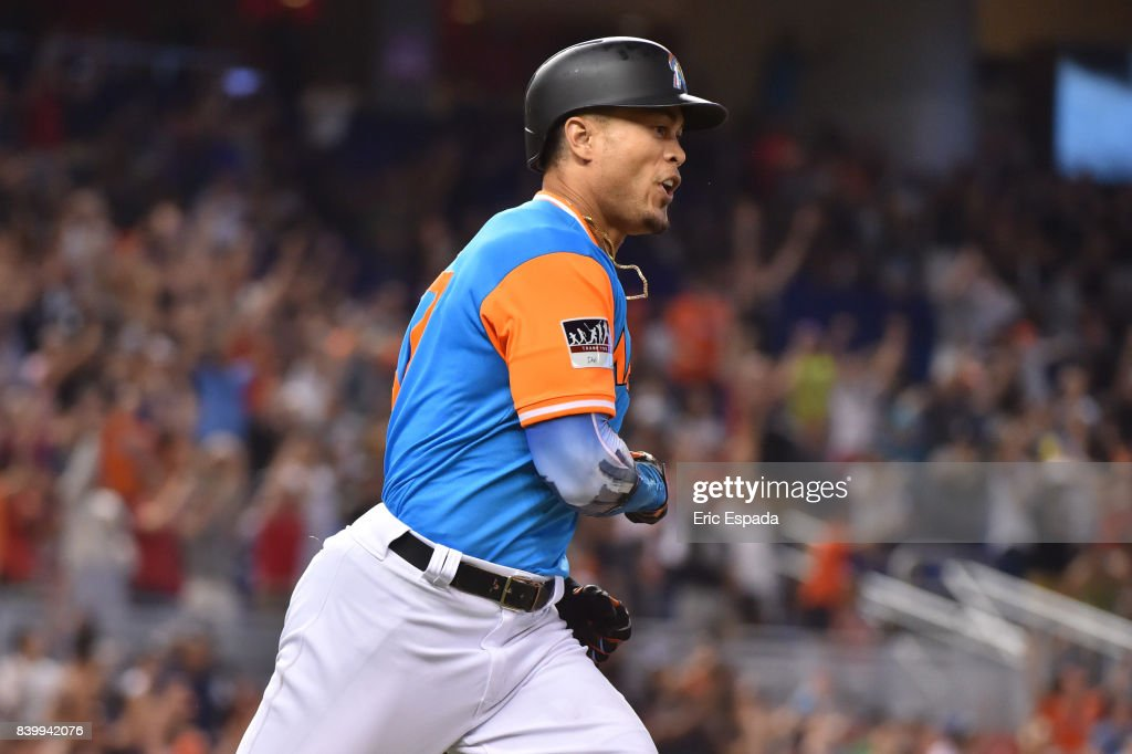 Giancarlo Stanton #27 of the Miami Marlins celebrates after hitting his 50th home run of the season in the eighth inning against the San Diego Padres at Marlins Park on August 27, 2017 in Miami, Florida.