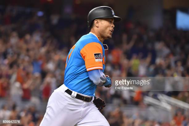 Giancarlo Stanton of the Miami Marlins celebrates after hitting his 50th home run of the season in the eighth inning against the San Diego Padres at...