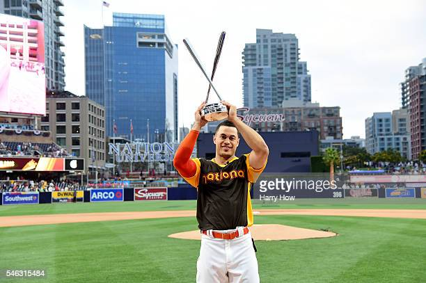 Giancarlo Stanton of the Miami Marlins celebrates after winning the TMobile Home Run Derby at PETCO Park on July 11 2016 in San Diego California